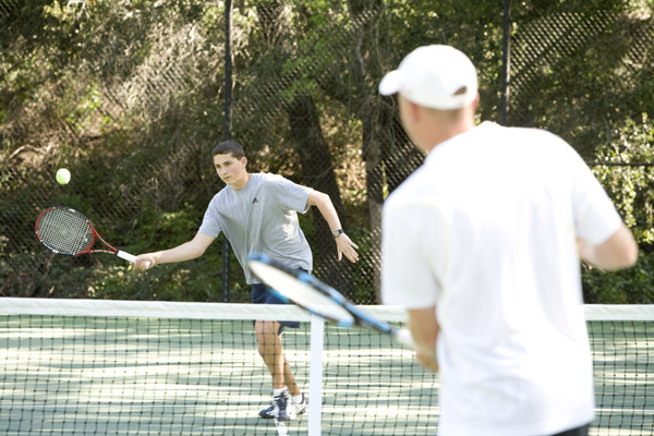 Tennis Director, Ryan Gaston, heads up our expert Tennis Department. Ryan and his staff offer a complete selection of activities for members of all ages and abilities. Our beautiful facility includes ten lighted hard courts set in a wooded area featuring a natural stream.